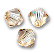 Swarovski Doppelkegel 6mm Crystal Golden Shadow x20